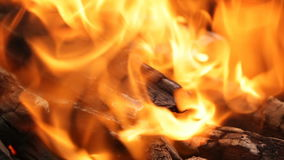 Burning coals, glowing charcoal and flame in barbecue grill stock footage
