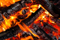 Burning coals on a grill Stock Images