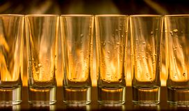 Burning cocktails in shot glass on a table Royalty Free Stock Images