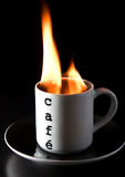Burning coffee. A cup of coffee burning Royalty Free Stock Photography
