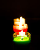 Burning colored candles Stock Photography