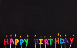 Burning colorful happy birthday candles Royalty Free Stock Image