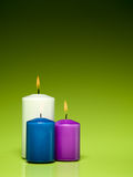 Burning colorful wax candles Stock Image