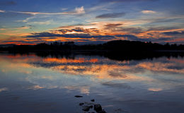 Burning colours of a Sunset across Swithland Water Royalty Free Stock Photo