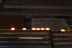 Burning commemoration candles in church. Several burning commemoration candles in church Royalty Free Stock Photos