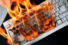 Burning computer keyboard Stock Image