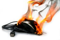 Burning computer mouse Stock Photography