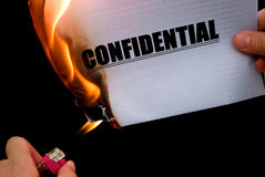 Burning a confidential paper Stock Images
