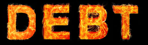 The burning debt letters on black background Stock Photo