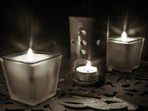 Burning decorative candles on a dark background stock photos