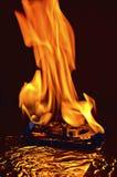 Burning del mecanismo impulsor de disco duro Fotos de archivo libres de regalías