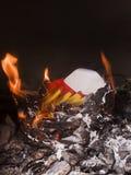Burning del papel del oro Foto de archivo libre de regalías