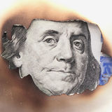 Burning dirty dollar bill as a symbol of inflation and the finan Stock Images