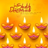 Burning diya on Diwali Holiday background for light festival of India with message in Hindi meaning Happy Dipawali Royalty Free Stock Photos