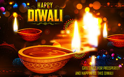 Burning diya on Happy Diwali Holiday background for light festival of India Royalty Free Stock Photos