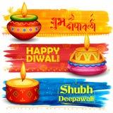Burning diya on Happy Diwali Holiday background for light festival of India Stock Photo