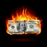 Burning dollar. On a black background for design Stock Photo