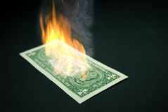Burning dollar Stock Photos