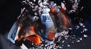 Burning dollar bill Stock Photos