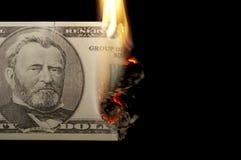 Burning dollar bill. On a black Royalty Free Stock Photo