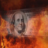 Burning dollar bill a symbol of world financial crisis Stock Images
