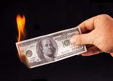 Burning dollar in hand. Royalty Free Stock Photos