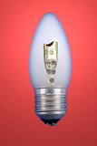 Burning dollar in a light bulb Royalty Free Stock Image