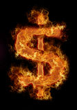 Burning dollar sign. On the black background Stock Images