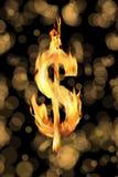 Burning dollar sign. Close up shot of burning dolar sign over black background Royalty Free Stock Photos