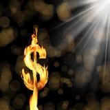 Burning dollar sign. Close up shot of burning dolar sign over black background Royalty Free Stock Images