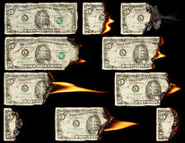 Burning dollars Stock Image