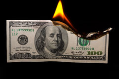 Burning dollars. Close up over black background Royalty Free Stock Photography