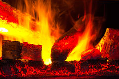 Burning down fire logs Royalty Free Stock Image