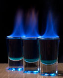 Burning drink in shot glass Stock Photo