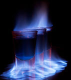 Burning drink in shot glass Stock Image
