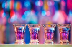 Burning drinks in shot glasses on a bar counter Royalty Free Stock Images