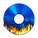 Burning DVD on white background. Blue DVD with fire burning on white background Royalty Free Stock Photography