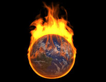 Burning Earth. A 3d image of burning earth, isolated on black Royalty Free Stock Images