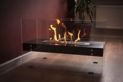 Burning eco fireplace. Stock Photos