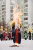 Burning effigy Maslency. Winter snow. We are seeing winter, we meet spring. stock photography