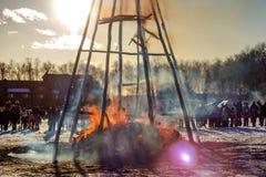 Burning effigy Maslenitsa at sunset. Russian spring holiday Maslenitsa Maslenica stock images