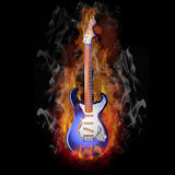 Burning Electric Guitar. Colorful electric Guitar burning in a hot fire Royalty Free Stock Image
