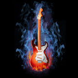 Burning Electric Guitar. Colorful electric Guitar burning in a hot fire Royalty Free Stock Photos