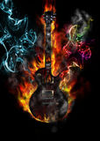 Burning electric guitar concept. With flames and colored smoke Royalty Free Stock Image