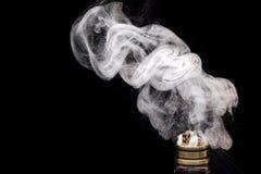 Burning of Electronic cigarette. Popular vaporizing e-cig gadge Stock Photo
