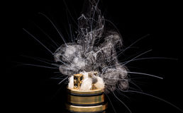 Burning of Electronic cigarette. Popular vaporizing e-cig gadge Stock Photography
