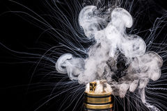 Burning of Electronic cigarette. Popular vaporizing e-cig gadge. T to vape glycerin e-liquid stock photo