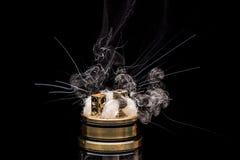 Burning of Electronic cigarette. Popular vaporizing e-cig gadge Royalty Free Stock Images