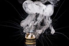 Burning of Electronic cigarette. Popular vaporizing e-cig gadge Stock Images