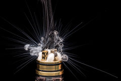 Burning of Electronic cigarette. Popular vaporizing e-cig gadge Royalty Free Stock Photography